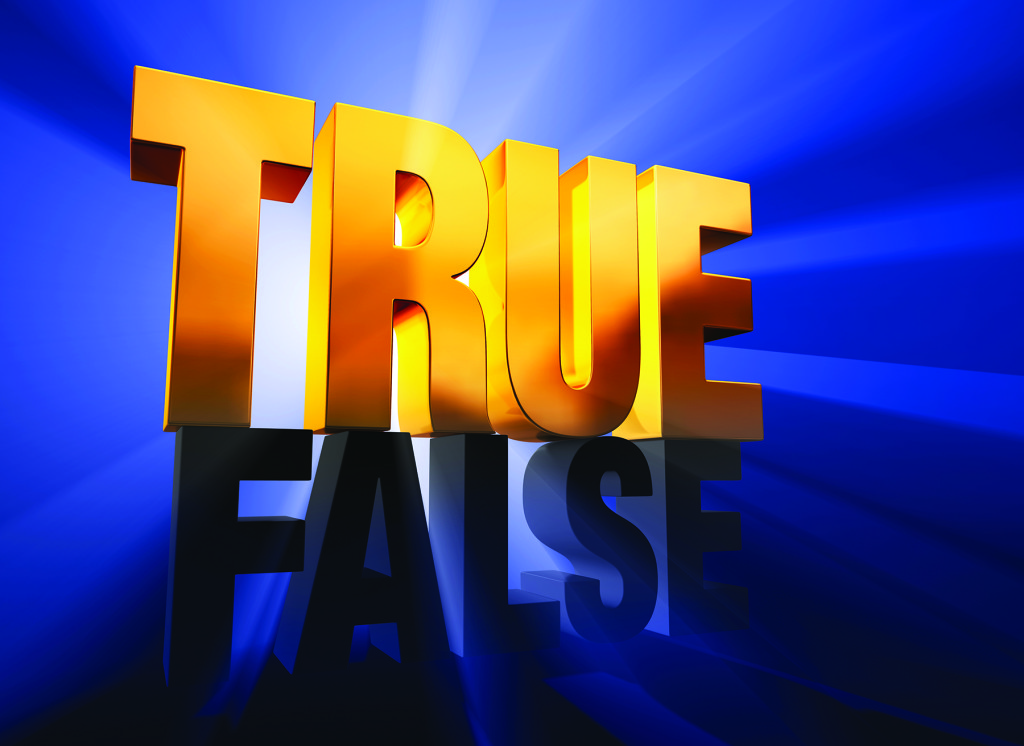 """A shiny, gold """"TRUE"""" sits atop a dark gray """"FALSE"""" on a deep blue background brilliantly back lit with light rays shining through both words."""