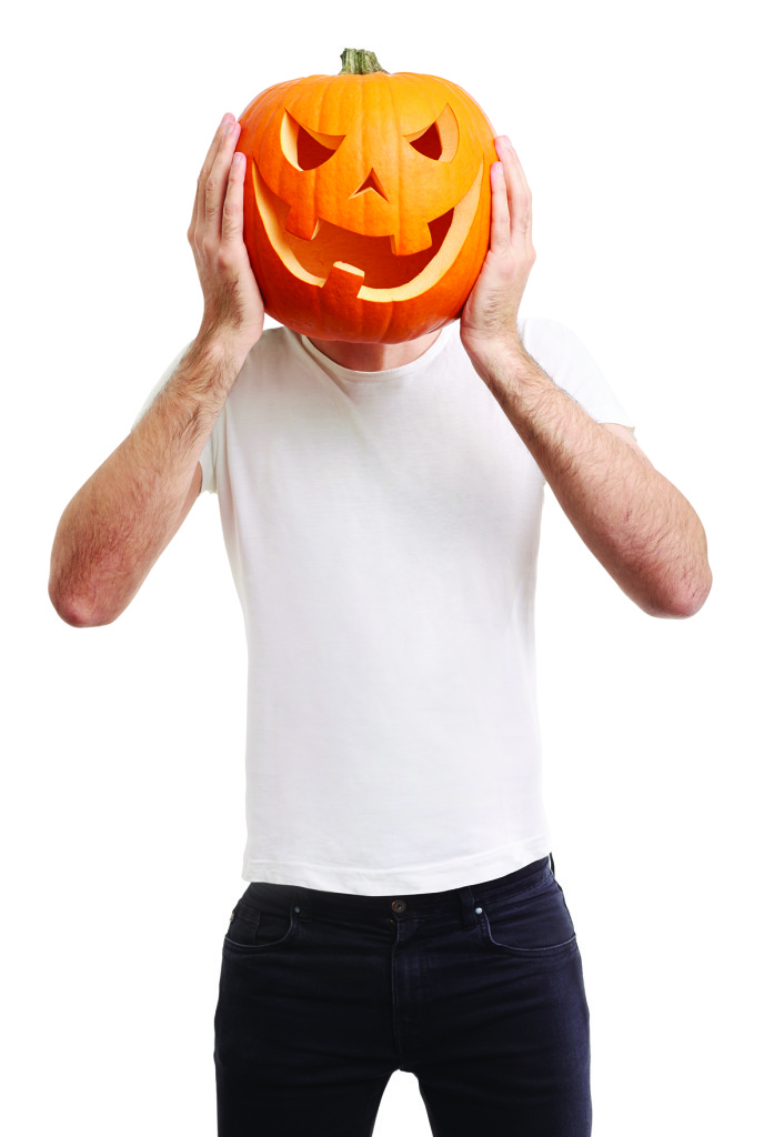 Halloween pumpkin on man head, joking, clipping path included