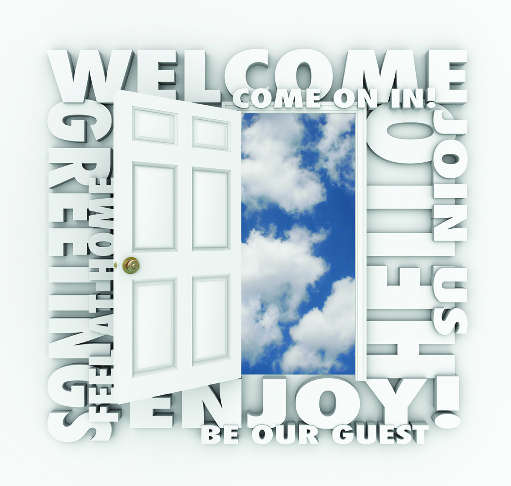 Welcome words around an open door to illustrate concepts like invitation, greetings, enjoyment, guest, service, friendliness and joining